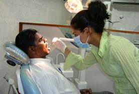 A volunteer observes a dental check-up at one of our Dentistry internship placements.