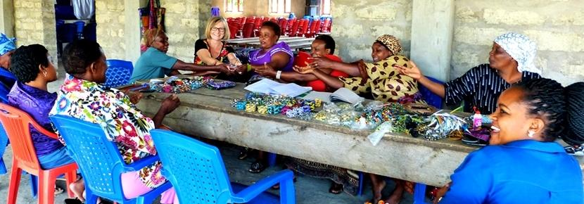 A group of local business women making jewellery for their business with the Projects Abroad Micro-finance project in Tanzania