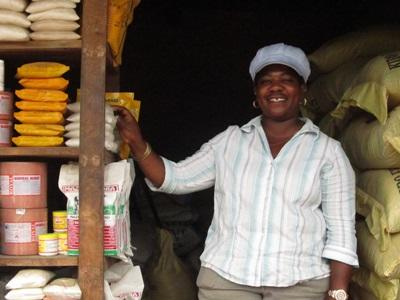 Local woman who is participating in Projects Abraod Micro Finance project stands at her place of business in Tanzania