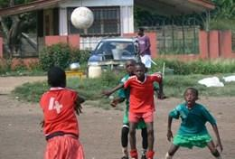 A group of young boys in Ghana play a soccer match together using the skills taught to them by one of our volunteers.