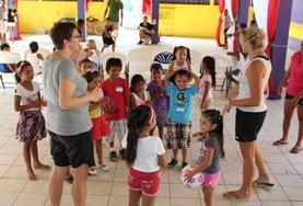 School Sports volunteers play a ball game with young children in Belize to promote physical development and fitness.