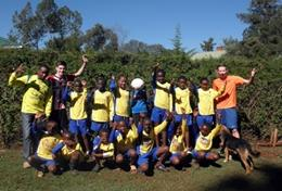 A local soccer team poses together before a sports lesson at our volunteer School Sports placement in Kenya.